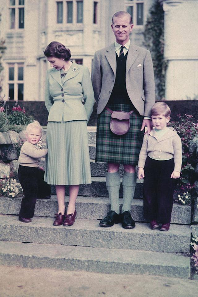"""<div class=""""caption-credit""""> Photo by: Courtesy of Studio Lisa/Hulton Archive/Getty Image</div><div class=""""caption-title"""">Queen Elizabeth II, United Kingdom, 1952</div>Outside Balmoral Castle, the Royal couple stand with their young children. <br> <br> <b>MORE FROM ELLE: <br> <a rel=""""nofollow"""" target="""""""" href=""""http://www.elle.com/pop-culture/celebrities/50-states-face-off?link=rel&dom=yah_life&src=syn&con=blog_elle&mag=elm"""">The Great American Face-Off</a> <br> <a rel=""""nofollow"""" target="""""""" href=""""http://www.elle.com/fashion/celebrity-style/suri-cruise-best-style-moments?link=rel&dom=yah_life&src=syn&con=blog_elle&mag=elm"""">Suri Cruise's Best Fashion Looks</a></b> <br>"""