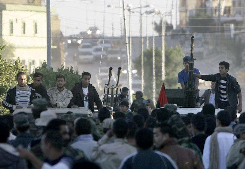 Libyans rush to the streets as they celebrate the arrest of Seif Al-Islam Kadhafi in Zintan on November 19, 2011