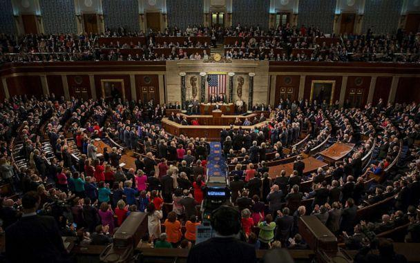 PHOTO: Members of Congress stand up to applaud as President Barack Obama speaks during his final State of the Union to a joint session of Congress in the House Chamber on Capitol Hill in Washington, Jan. 12, 2016. (Al Drago/CQ-Roll Call via Getty Images, FILE)