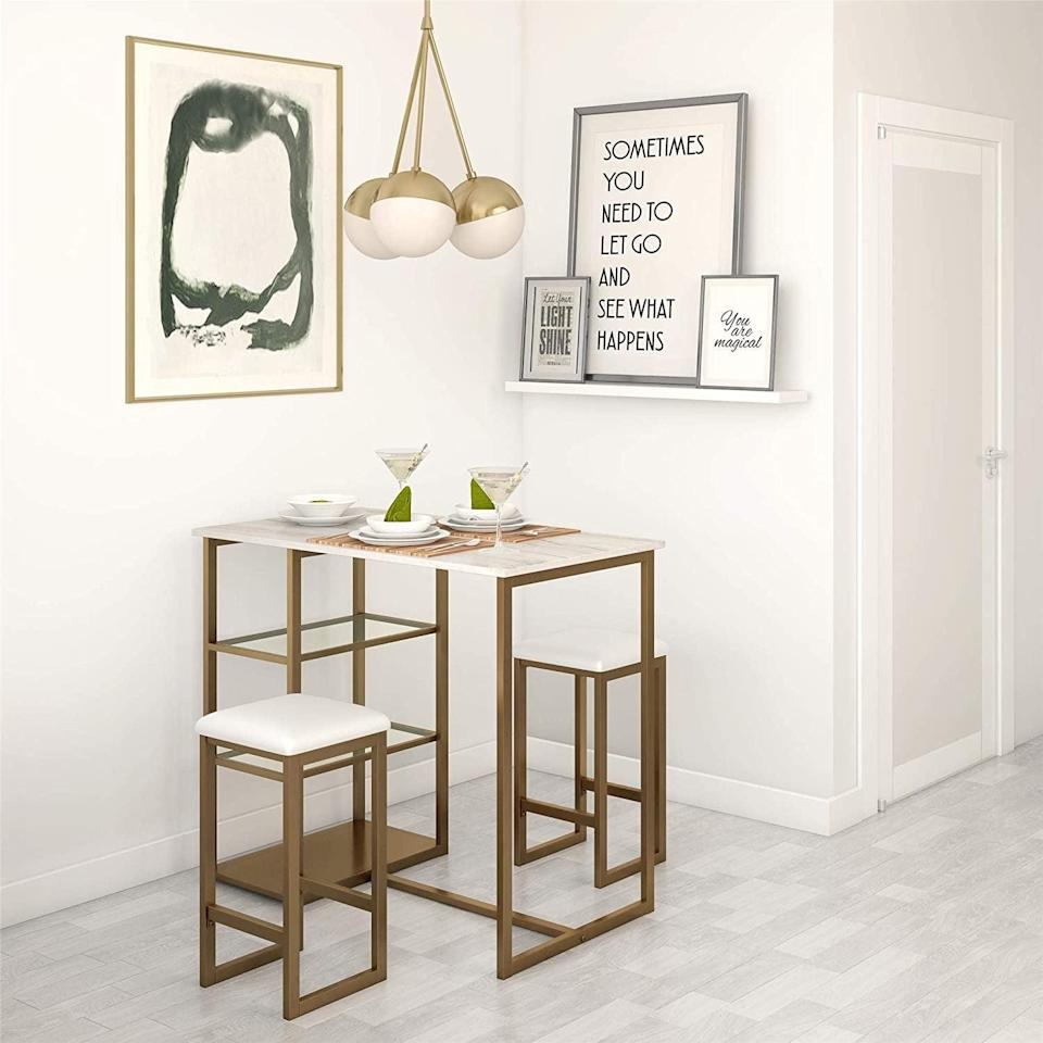 <p>If you've been on the hunt for a mini dining set, tuck this compact <span>Dorel Living Tanner 3-Piece Brass Pub Set </span> ($170) in a corner of your kitchen. It will look elegant and take up very little space.</p>