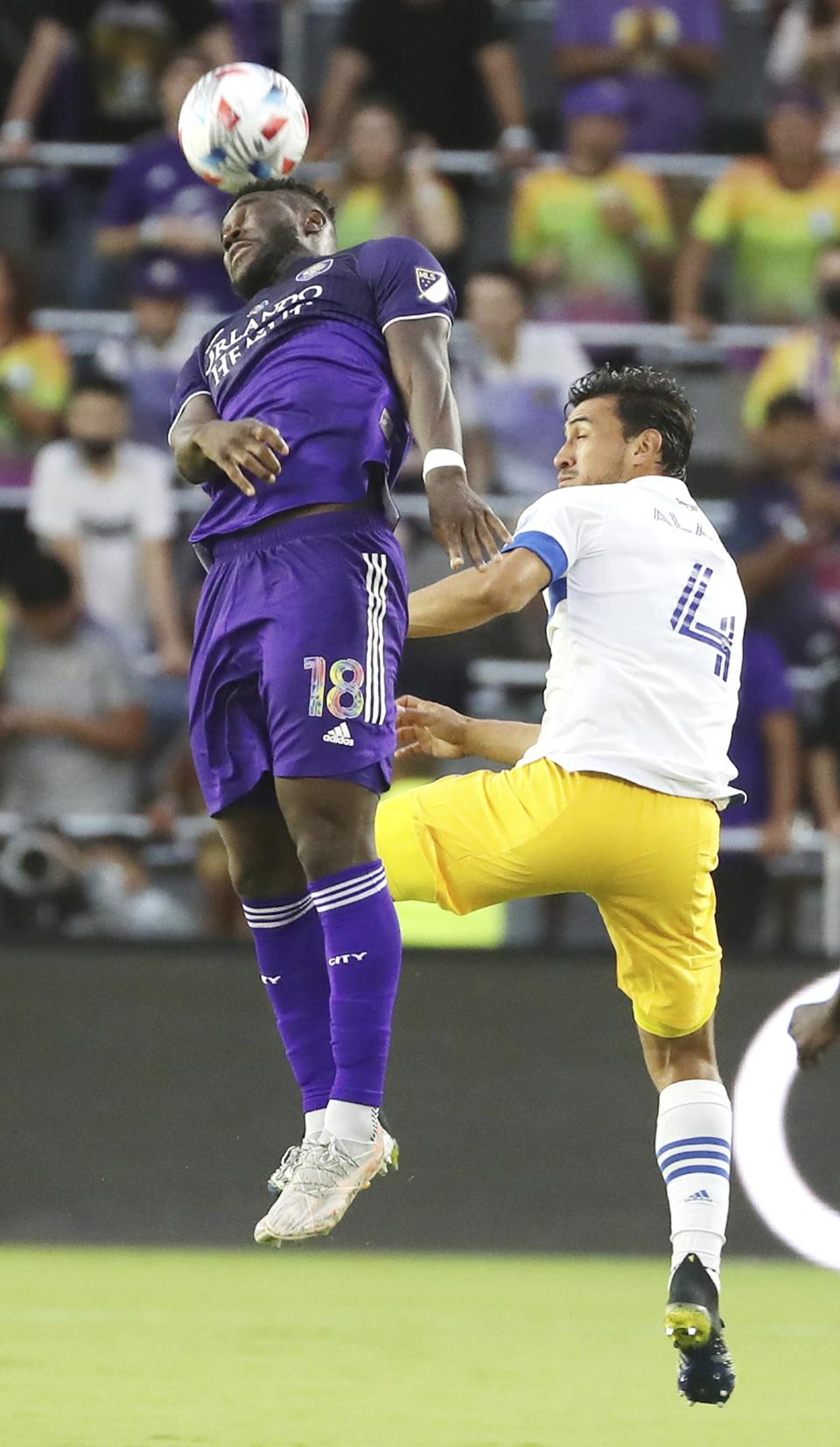 Orlando player Daryl Dike, left, leaps to head the ball beside San Jose player O. Alanis, right, during a MSL soccer match in Orlando, Fla., on Tuesday, June 22, 2021. (Stephen M. Dowell /Orlando Sentinel via AP)