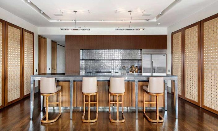Well-lit contemporary kitchen inside David Bowie's old Manhattan apartment, recently sold for $16.8 million.