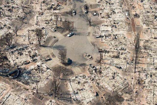 <p>In this aerial view, burned properties are seen in Santa Rosa, Calif., on Oct. 12, 2017. (Photo: Josh Edelson/AFP/Getty Images) </p>