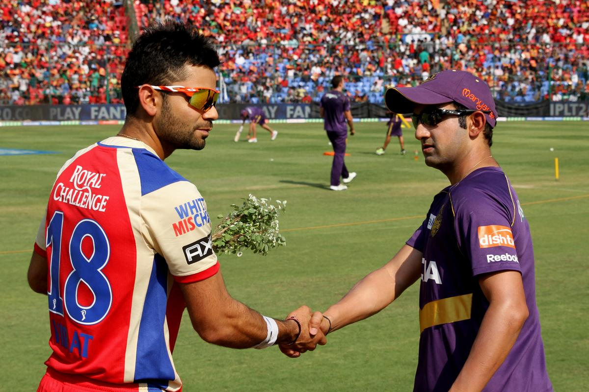 Virat Kohli and Gautam Gambhir shake during toss for  match 12 of the Pepsi Indian Premier League between The Royal Challengers Bangalore and The Kolkata Knight Riders  held at the M. Chinnaswamy Stadium, Bengaluru  on the 11th April 2013Photo by Prashant Bhoot-IPL-SPORTZPICS Use of this image is subject to the terms and conditions as outlined by the BCCI. These terms can be found by following this link:https://ec.yimg.com/ec?url=http%3a%2f%2fwww.sportzpics.co.za%2fimage%2fI0000SoRagM2cIEc&t=1498616845&sig=so1sdD7FrlC.uXgfrCxaCg--~C