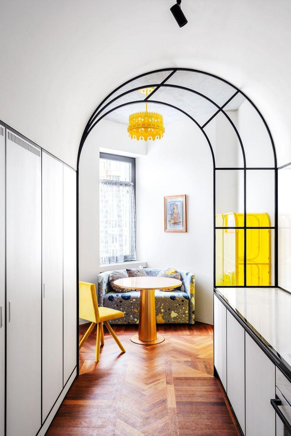 """<p><a href=""""http://crosby-studios.com/"""" rel=""""nofollow noopener"""" target=""""_blank"""" data-ylk=""""slk:Crosby Studios"""" class=""""link rapid-noclick-resp"""">Crosby Studios</a> used glass interiors to frame a tinny breakfast nook off a gallery kitchen. It makes the eat-in kitchen feel a little larger and distinct since it separates the cooking and dining areas—but the transparent arch ensures that the two spaces can still share the light. If you're in a super small space you don't want to or a rental that you can't alter, slide in a settee or oversized armchair. It will feel more like a banquette while still accommodating your needs. </p>"""