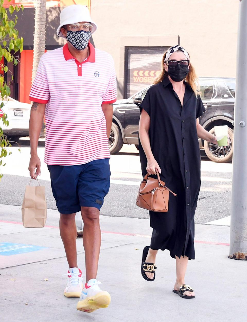 <p>Chris Ivery and Ellen Pompeo make a stylish pair while out and about in L.A. on Wednesday. </p>
