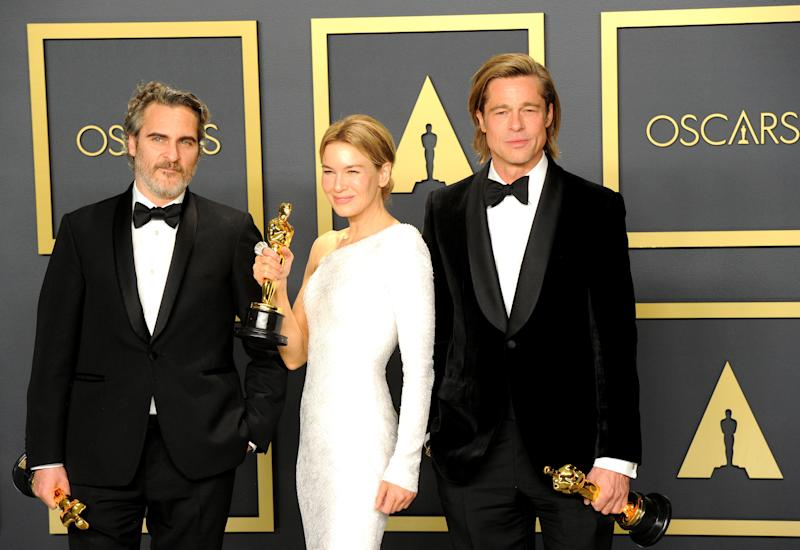 HOLLYWOOD, CA - FEBRUARY 09: Joaquin Phoenix, Renée Zellweger and Brad Pitt pose inside The Press Room of the 92nd Annual Academy Awards held at Hollywood and Highland on February 9, 2020 in Hollywood, California. (Photo by Albert L. Ortega/Getty Images)