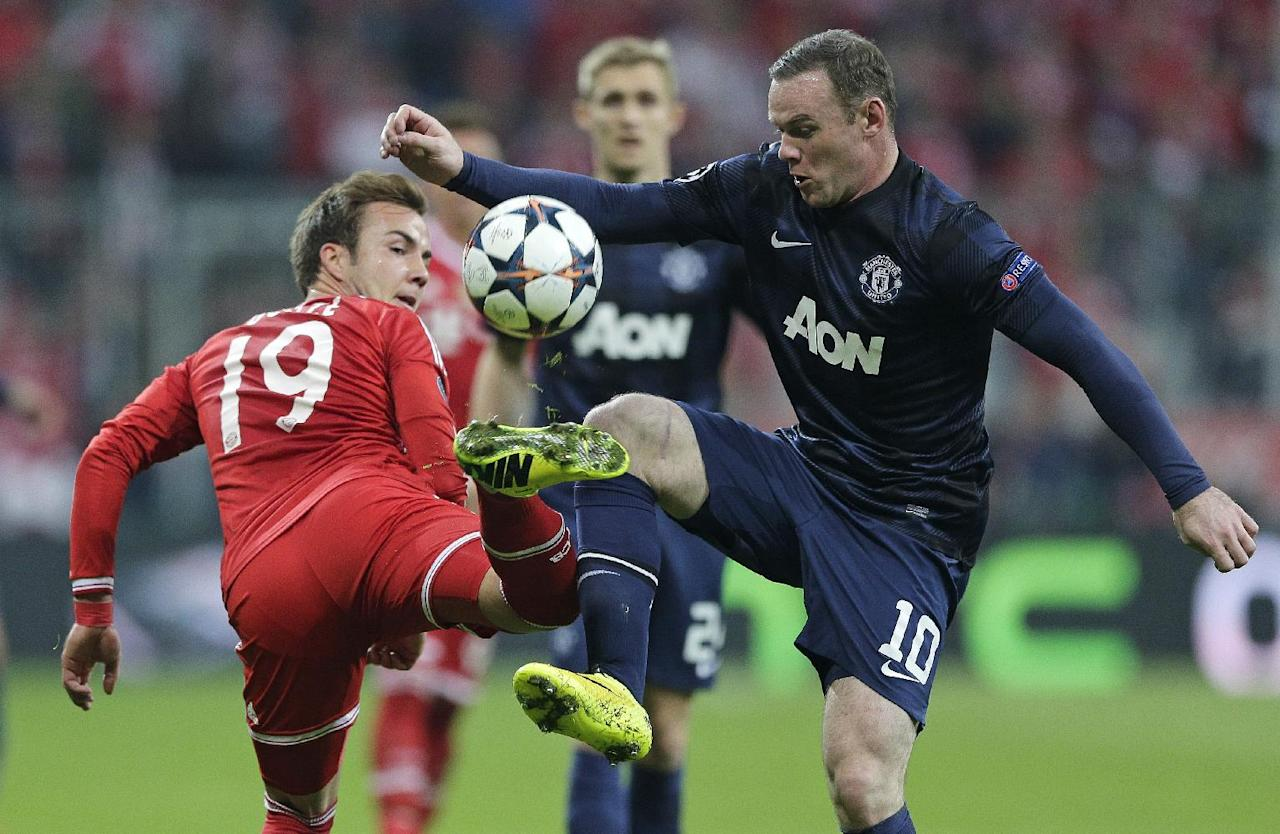 Bayern's Mario Goetze, left, is challenged by Manchester United's Wayne Rooney during the Champions League quarterfinal second leg soccer match between Bayern Munich and Manchester United in the Allianz Arena in Munich, Germany, Wednesday, April 9, 2014. (AP Photo/Matthias Schrader)