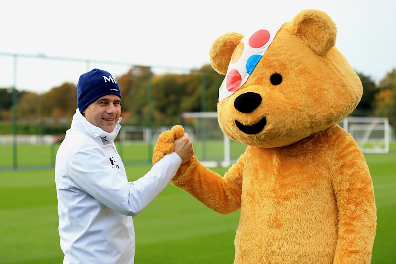ENFIELD, ENGLAND - OCTOBER 28: Children In Need's Pudsey Bear meets Tottenham Manager Mauricio Pochettino at the club's training ground on October 28, 2015 in Enfield, England. (Photo by Tottenham Hotspur FC via Getty Images)