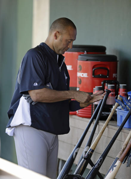 New York Yankees shortstop Derek Jeter (2) prepares in the dugout before taking batting practice prior to a spring training baseball game against the Philadelphia Phillies in Clearwater, Fla., Tuesday, March 19, 2013. Jeter was pulled from the lineup. (AP Photo/Kathy Willens)
