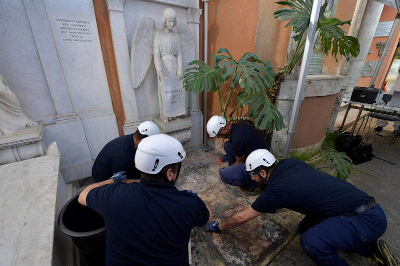 Pictured are the tombs being opened in a cemetery on the Vatican's grounds to test the DNA of bones in the investigation into the disappearance of Emanuela Orlandi.