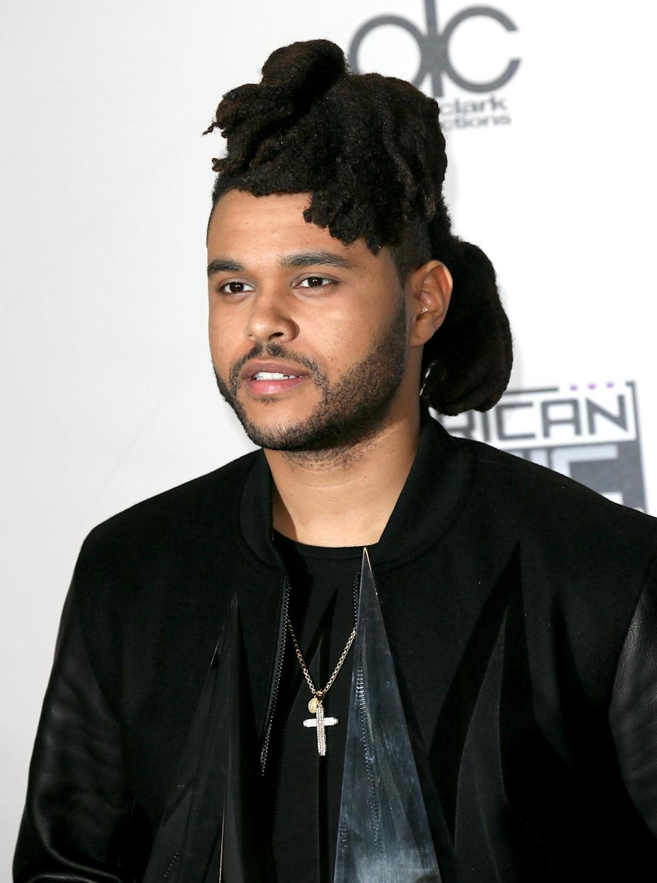 <p>By 2015, he was usually seen sporting his locs in a half-up, half-down hairstyle as they grew longer.</p>