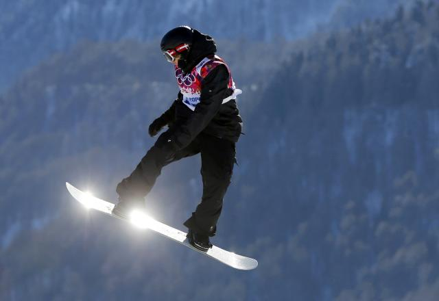 Austria's Clemens Schattschneider performs a jump during the men's snowboard slopestyle qualifying session at the 2014 Sochi Olympic Games in Rosa Khutor February 6, 2014. REUTERS/Lucas Jackson (RUSSIA - Tags: OLYMPICS SPORT SNOWBOARDING TPX IMAGES OF THE DAY)