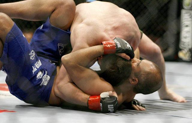 Ex-UFC welterweight champion Matt Hughes (top) moves into position against Royce Gracie at UFC 60 in 2006. (Getty Images)
