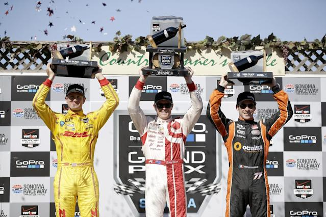 (L-R) Second-placed Ryan Hunter-Reay, race winner Scott Dixon and third-placed Simon Pagenaud with their trophies at the end of the IndyCar Grand Prix of Sonoma on August 24, 2014 in California (AFP Photo/Ezra Shaw)