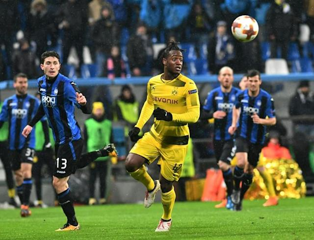 Atalanta's defender from Italy Mattia Caldara (L) fights for the ball with Borussia Dortmund's forward from Belgium Michy Batshuayi, who accused Atalanta fans of racist abuse after his team's Europa league match on February 22, 2018