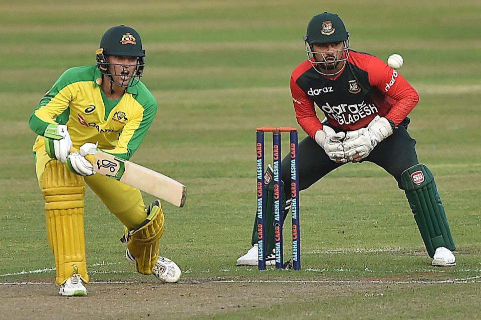 Australia's wicketkeeper Alex Carey (pictured left) plays a shot against Bangladesh.