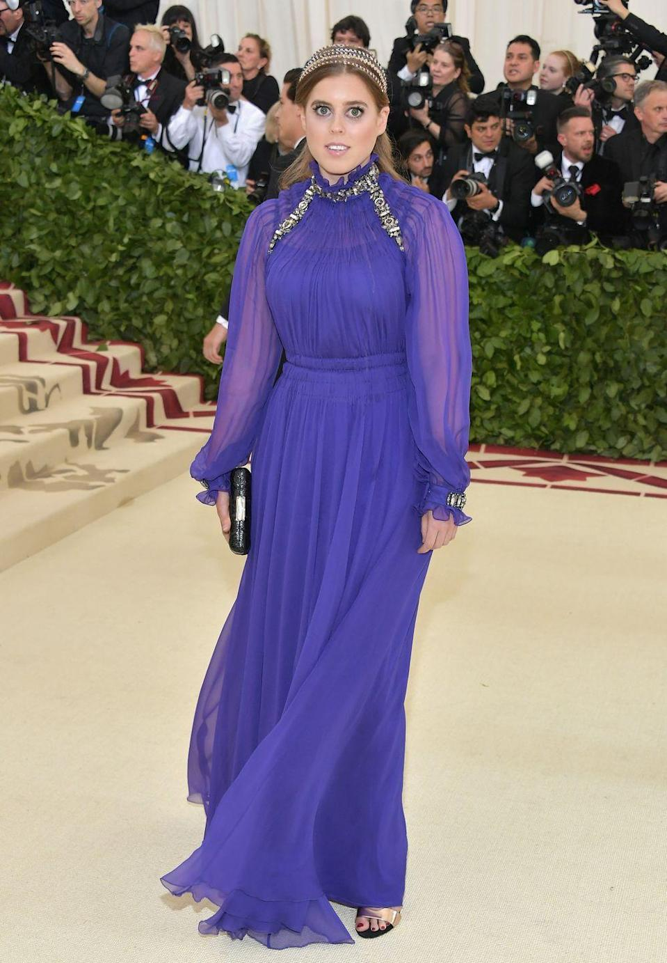 <p>Princess Beatrice attended the 2018 Met Gala wearing a regal shade of purple. The young royal wore the chiffon Alberta Ferretti gown with a high neck and billowing sleeves.</p>