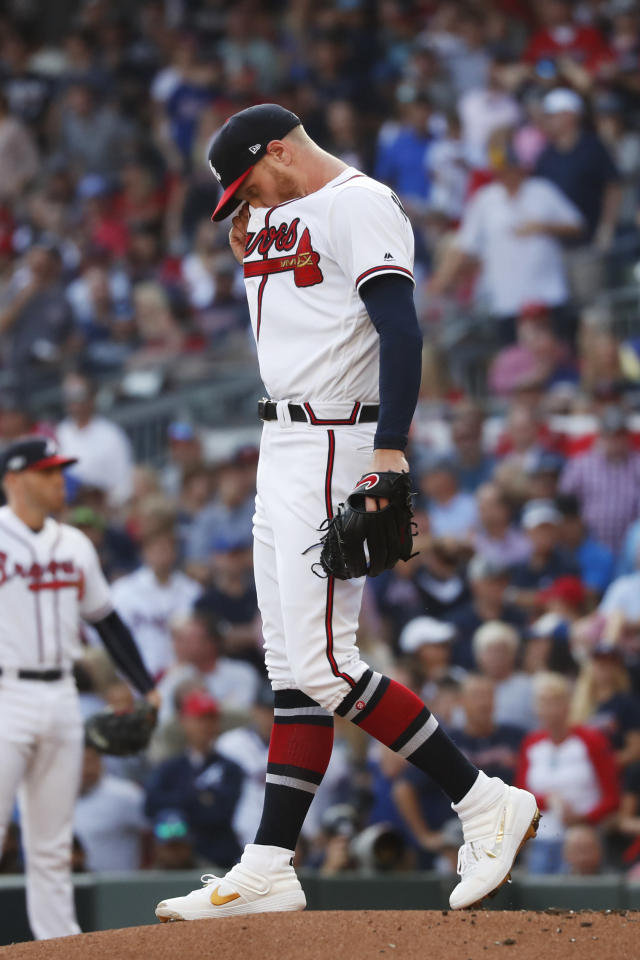 Atlanta Braves starting pitcher Mike Foltynewicz stands on the mound after walking St. Louis Cardinals' Matt Carpenter to score a run in the first inning of Game 5 of their National League Division Series baseball game Wednesday, Oct. 9, 2019, in Atlanta. (AP Photo/John Bazemore)