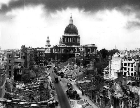 St Pauls Cathedral stands defiant following the Blitz - Credit: Getty