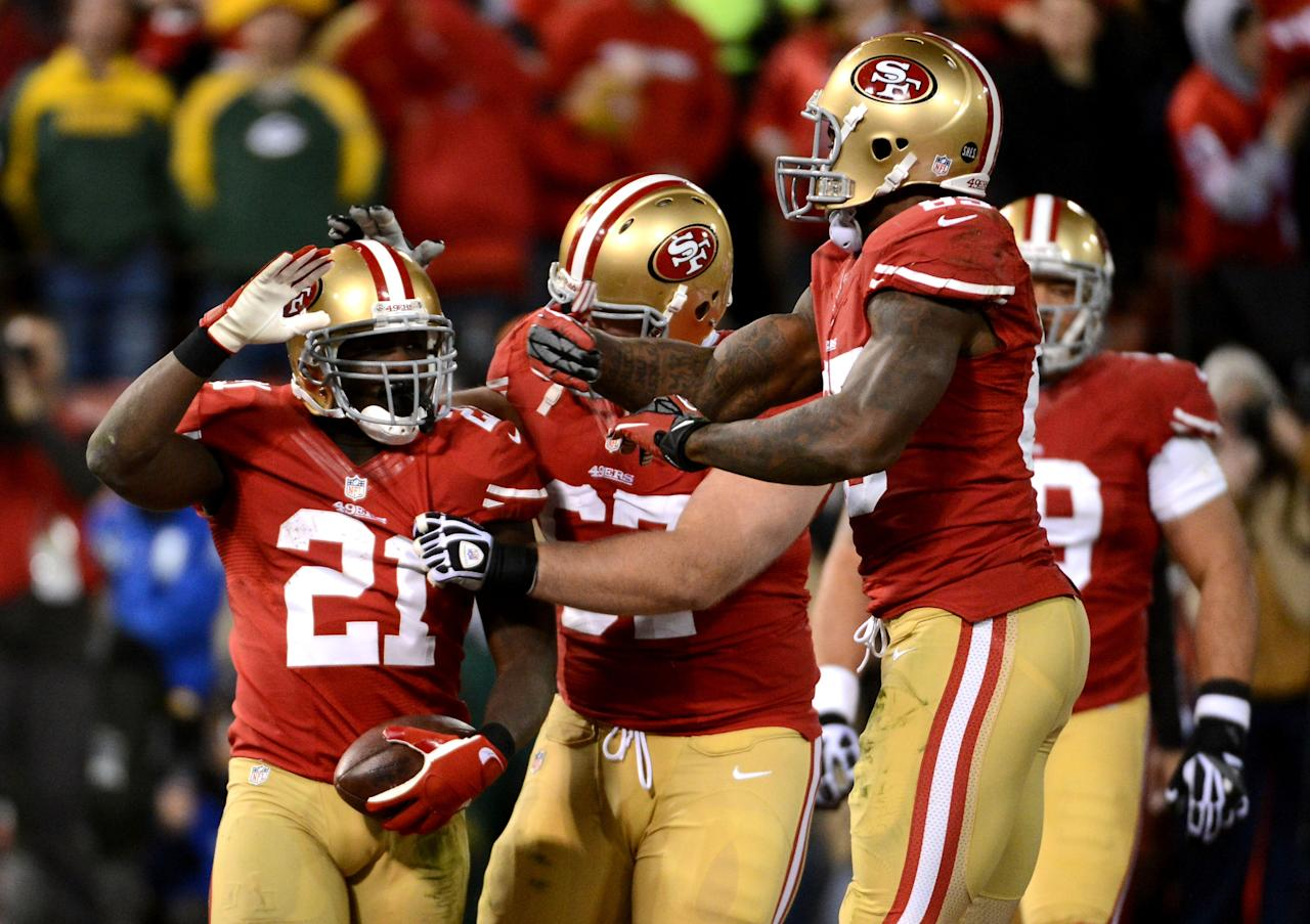 SAN FRANCISCO, CA - JANUARY 12:  Running back Frank Gore #21 of the San Francisco 49ers celebrates with his teammates after scoring a touchdown in the fourth quarter against the Green Bay Packers during the NFC Divisional Playoff Game at Candlestick Park on January 12, 2013 in San Francisco, California.  (Photo by Harry How/Getty Images)