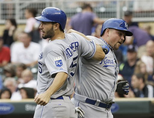 Kansas City Royals' Billy Butler, right, is congratulated by Eric Hosmer after Butler's three-run home run off Minnesota Twins pitcher P.J. Walters in the first inning of a baseball game Friday, June 28, 2013, in Minneapolis. (AP Photo/Jim Mone)