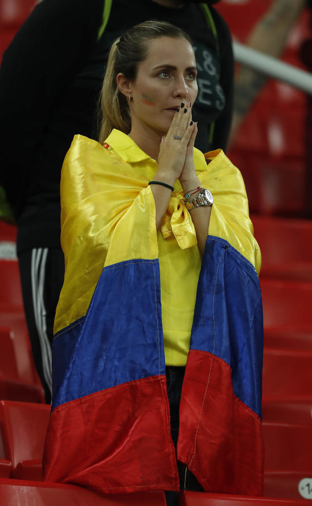 <p>Colombia supporters react after their team lost the round of 16 match between Colombia and England at the 2018 soccer World Cup in the Spartak Stadium, in Moscow, Russia, Tuesday, July 3, 2018. (AP Photo/Alastair Grant) </p>