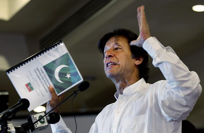 "In this Tuesday, April 9, 2013 photo, Pakistan's former cricket star-turned-politician Imran Khan gestures as he speaks about his party, Pakistan Tehreek-e-Insaf in Islamabad, Pakistan. Khan, who many analysts believe will end up playing a key role in the opposition after the election, has been even more critical of Pakistan's relationship with the U.S., saying he would ""end the system of American slavery."" (AP Photo/B.K. Bangash)"