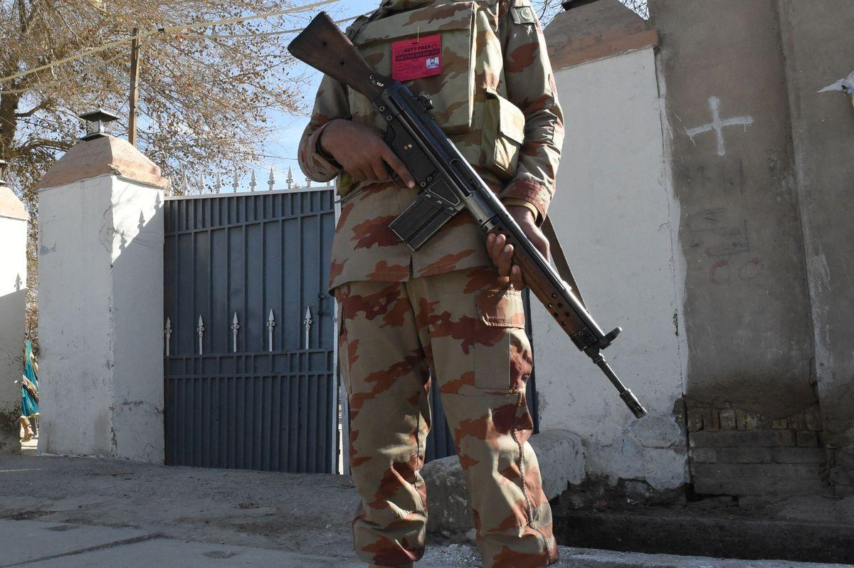 A Pakistani security personnel stands guard during the Christmas Day mass in Quetta on December 25, 2017. A suicide bomb attack on a Pakistan church claimed by the Islamic State group killed at least eight people and wounded 30 during a service on December 17, just over a week before Christmas. / AFP PHOTO / BANARAS KHAN (Photo credit should read BANARAS KHAN/AFP/Getty Images)