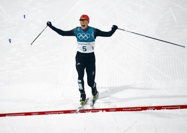 Nordic Combined Events – Pyeongchang 2018 Winter Olympics – Men's Individual 10km Final – Alpensia Cross-Country Skiing Centre - Pyeongchang, South Korea – February 14, 2018 - Eric Frenzel of Germany celebrates his win as he crosses the finish line. REUTERS/Kai Pfaffenbach