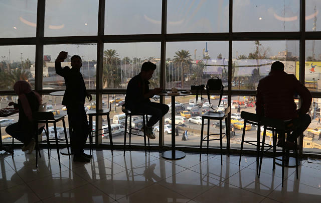 In this Feb. 10, 2019 photo, people eat in a restaurant at a shopping mall in Baghdad, Iraq. For the first time in years, Iraq is not at war. The defeat of the Islamic State group in late 2017 after a ruinous four-year conflict has given the population a moment of respite, and across the capital Baghdad there is a guarded sense of hope. (AP Photo/Khalid Mohammed)