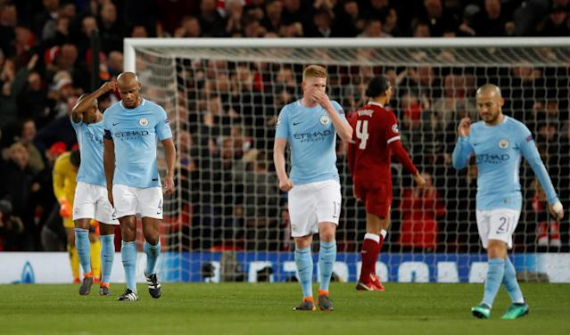 <p>Soccer Football – Champions League Quarter Final First Leg – Liverpool vs Manchester City – Anfield, Liverpool, Britain – April 4, 2018 Manchester City's Vincent Kompany looks dejected after Liverpool's Sadio Mane (not pictured) scored their third goal Action Images via Reuters/Carl Recine </p>