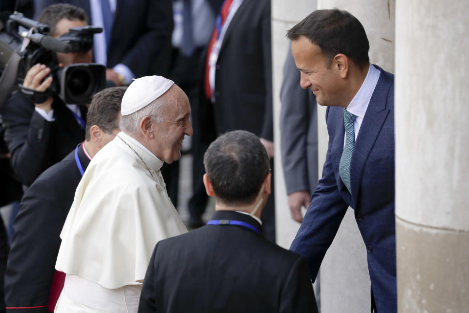 Pope Francis meets with Irish Prime Minister Leo Varadkar, right, as he arrives at Dublin Castle, Ireland, Saturday, Aug. 25, 2018. Pope Francis is on a two-day visit to Ireland. (AP Photo/Matt Dunham)