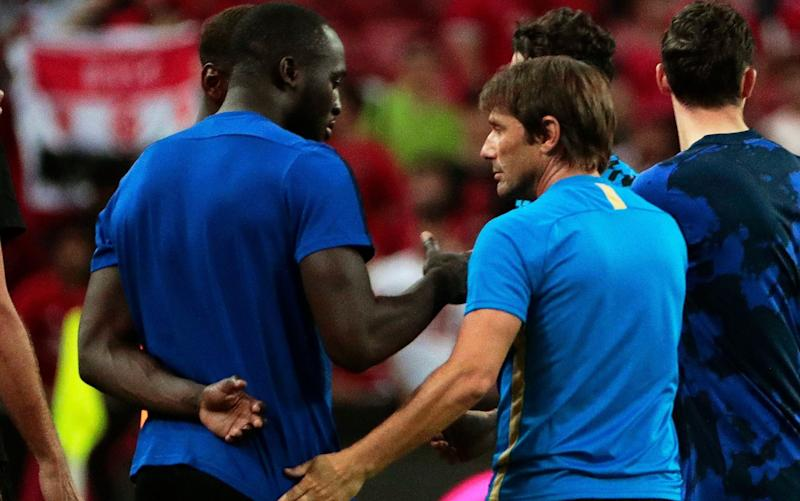 Romelu Lukaku has a chat with Inter coach Antonio Conte after the match - REX