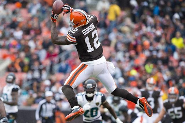 Josh Gordon, who has been suspended for at least one year by the National Football League for a repeat alcohol violation, catches a pass in a December 2013 game CLEVELAND, OH - DECEMBER 1: Wide receiver Josh Gordon #12 of the Cleveland Browns catches a pass during the first half against the Jacksonville Jaguars at FirstEnergy Stadium on December 1, 2013 in Cleveland, Ohio. Jason Miller/Getty Images/AFP (AFP Photo/Matt Sullivan)