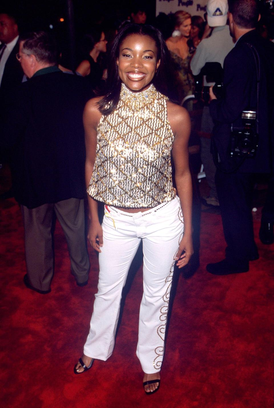 <p>Gabrielle played Isis, captain of the East Compton Clovers cheer team. She arrived on the red carpet in the ultimate 2000s look consisting of a shift halter top covered in sequins and beads coordinated with low-rise gold studded flares and heeled sandals.</p>