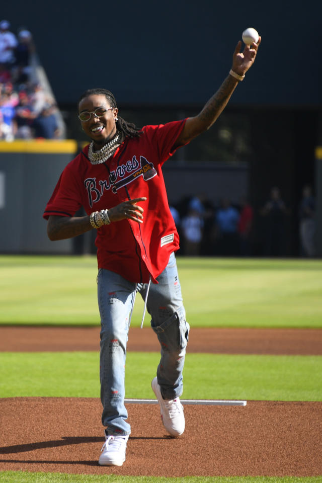American rapper Quavo, throws the first ceremonial pitch ahead of Game 2 of a best-of-five National League Division Series between the Atlanta Braves and the St. Louis Cardinals, Friday, Oct. 4, 2019, in Atlanta. (AP Photo/John Amis)
