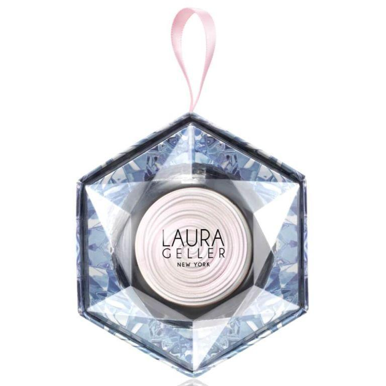 """<p><a rel=""""nofollow noopener"""" href=""""https://www.beautybay.com/makeup/laurageller/bakedgelatoswirlilluminatorchristmasornament"""" target=""""_blank"""" data-ylk=""""slk:Beauty Bay"""" class=""""link rapid-noclick-resp"""">Beauty Bay</a> - £21</p><p>If you like your cheekbones to be as glitzy as the Christmas lights on Regent Street, Laura Geller's holographic illuminator has got you covered. Packed with pigment, it feels almost creamy on application, and you only need a little bit to give good glow. Obsessed.</p>"""