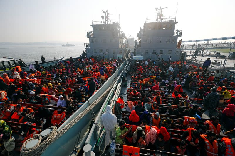 Rohingya refugees are seen on board of two navy vessels that will carry them to Bhasan Char island, in Chattogram