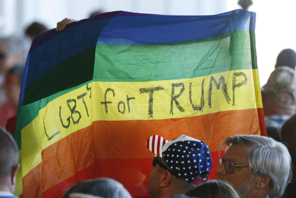 Supporters hold up an LGBT+ Pride flag for Republican presidential candidate Donald Trump. (George Frey/Getty Images