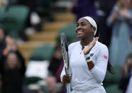 Coco Gauff of the US celebrates winning the women's singles first round match against Britain's Francesca Jones on day two of the Wimbledon Tennis Championships in London, Tuesday June 29, 2021. (AP Photo/Alastair Grant)