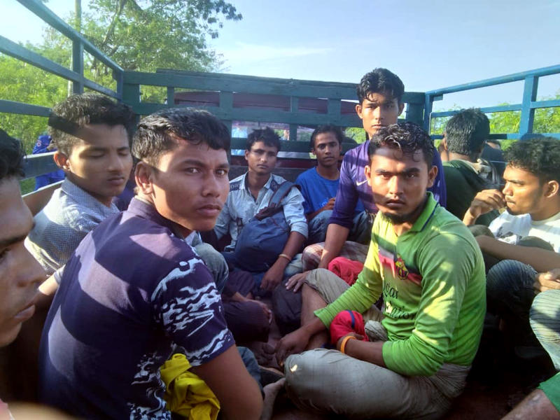 In this undated handout photo released April 8, 2019, dozens of people believed to be Rohingya Muslims from Myanmar who were dropped off from a boat are pictured on a truck before being taken to a police station near Sungai Belati, Perlis, Malaysia. Malaysian police say a group of 41 Muslim Rohingya men have been detained in the northernmost state of Perlis, the second batch to have landed in the country in just over a month. (Malaysia Royal Police via AP)