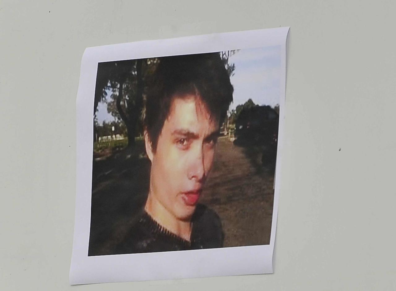 A picture of Elliot Rodger is displayed during a news conference by Santa Barbara County Sheriff Bill Brown (not shown) at Sheriff headquarters in Santa Barbara, California May 24, 2014. Brown confirmed that Elliot Oliver Robertson Rodger is the suspect in a mass shooting that left 6 people dead and 13 injured in the college neighborhood of Isla Vista near UC Santa Barbara. REUTERS/Phil Klein (UNITED STATES - Tags: CRIME LAW)