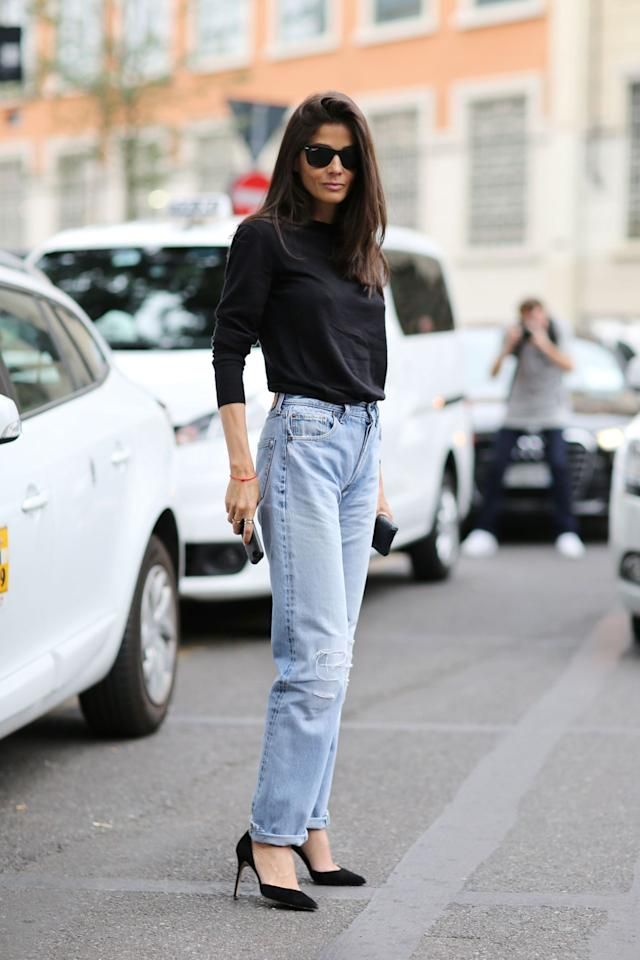 """<p>High-waisted jeans get a bad rap. They were the hottest denim style of the '90s, but the """"mom jeans""""reputation in recent years meant that kids, young adults, and even""""hip moms"""" would't touch them in a vintage bin. Now those same receptacles are empty, having been cleaned out by early adopters of the old-new trend. But if your local consignment shop is sold out and eBay seems too daunting (or if previously worn stuff just gives you the heebie-jeebies), brands are producing the silhouette once again. The high waist is flattering — no more sucking in! — and can be worn both baggy and more fitted. <i>Photo: Rex Images</i></p>"""