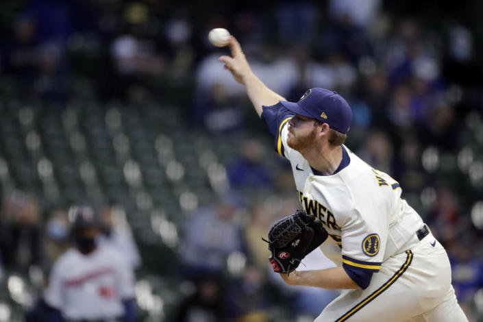Milwaukee Brewers' Brandon Woodruff pitches during the first inning of an Opening Day baseball game against the Minnesota Twins Thursday, April 1, 2021, in Milwaukee. (AP Photo/Aaron Gash)