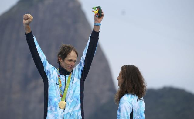 2016 Rio Olympics - Sailing - Victory Ceremony - Mixed Multihull - Nacra 17 - Victory Ceremony - Marina de Gloria - Rio de Janeiro, Brazil - 16/08/2016. Santiago Lange (ARG) of Argentina and Cecilia Carranza (ARG) of Argentina celebrate gold medal. REUTERS/Benoit Tessier FOR EDITORIAL USE ONLY. NOT FOR SALE FOR MARKETING OR ADVERTISING CAMPAIGNS.