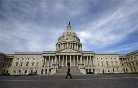 A lone worker passes by the U.S. Capitol building in Washington