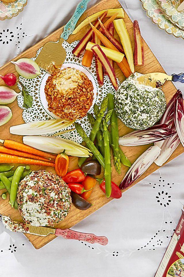 """<p>These cheese balls can easily be prepared ahead of time and need little more than colorful spices, seeds, or nuts to dress them up for a party.</p><p><strong><a href=""""https://www.countryliving.com/food-drinks/recipes/a42436/cheese-ball-trio-recipe/"""" rel=""""nofollow noopener"""" target=""""_blank"""" data-ylk=""""slk:Get the recipe"""" class=""""link rapid-noclick-resp"""">Get the recipe</a>.</strong></p>"""