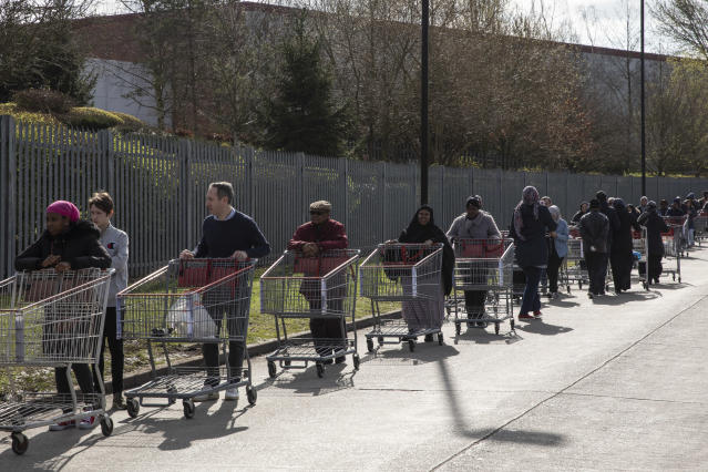 Shoppers form long queues ahead of the opening of a Costco wholesale store in Chingford, London, on Monday. (Getty Images)