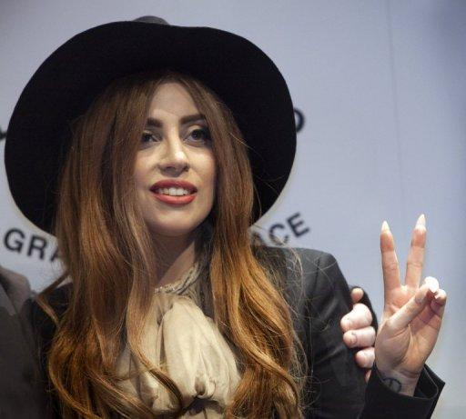 Stars took to Twitter en masse to welcome the Democratic incumbent's victory over Republican rival Mitt Romney, after a bruising campaign battle. Flamboyant pop diva Lady Gaga, seen here in October 2012, reacted to the clean-cut election win in typical off-beat style